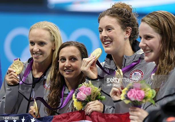 Gold medallists Dana Volmer Rebecca Soni Allison Schmitt and Missy Franklin of the United States pose on the podium during the medal ceremony for the...