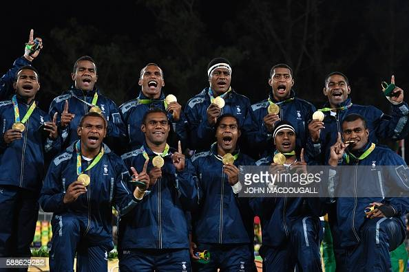 Gold medallists Fiji celebrate during the mens rugby sevens medal ceremony during the Rio 2016 Olympic Games at Deodoro Stadium in Rio de Janeiro...