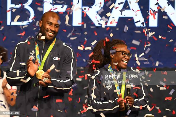 Gold medallists France's Teddy Riner and Emilie Andeol attend a medal ceremony at the 'Club France' on August 12 2016 during the Rio 2016 Olympic...