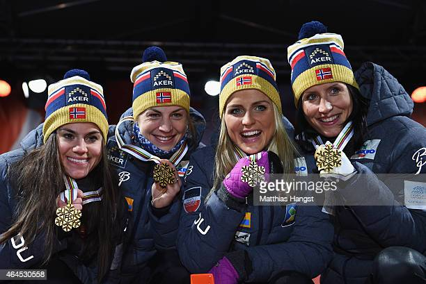 Gold medallists Heidi Weng Astrid Uhrenholdt Jacobsen Therese Johaug and Marit Bjoergen of Norway pose during the medal ceremony for the Women's 4 x...