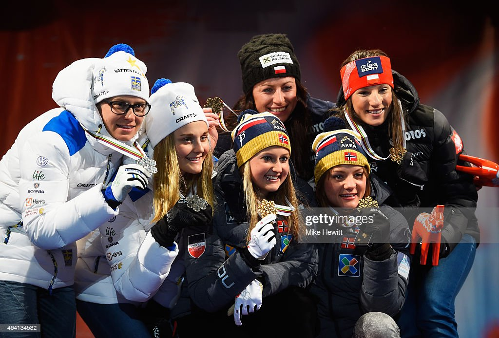Gold medallists <a gi-track='captionPersonalityLinkClicked' href=/galleries/search?phrase=Ingvild+Flugstad+Oestberg&family=editorial&specificpeople=7427144 ng-click='$event.stopPropagation()'>Ingvild Flugstad Oestberg</a> and <a gi-track='captionPersonalityLinkClicked' href=/galleries/search?phrase=Maiken+Caspersen+Falla&family=editorial&specificpeople=5646017 ng-click='$event.stopPropagation()'>Maiken Caspersen Falla</a> of Norway pose with silver medallists <a gi-track='captionPersonalityLinkClicked' href=/galleries/search?phrase=Ida+Ingemarsdotter&family=editorial&specificpeople=5640296 ng-click='$event.stopPropagation()'>Ida Ingemarsdotter</a> and <a gi-track='captionPersonalityLinkClicked' href=/galleries/search?phrase=Stina+Nilsson&family=editorial&specificpeople=10116472 ng-click='$event.stopPropagation()'>Stina Nilsson</a> of Sweden and bronze medallists Justyna Kowalczyk and Sylwia Jaskowiec of Poland during the medal ceremony for the Women's Cross-Country Team Sprint Final during the FIS Nordic World Ski Championships at the Lugnet venue on February 22, 2015 in Falun, Sweden.