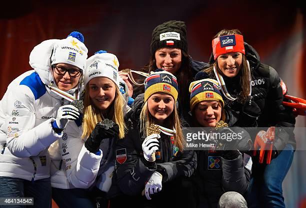 Gold medallists Ingvild Flugstad Oestberg and Maiken Caspersen Falla of Norway pose with silver medallists Ida Ingemarsdotter and Stina Nilsson of...