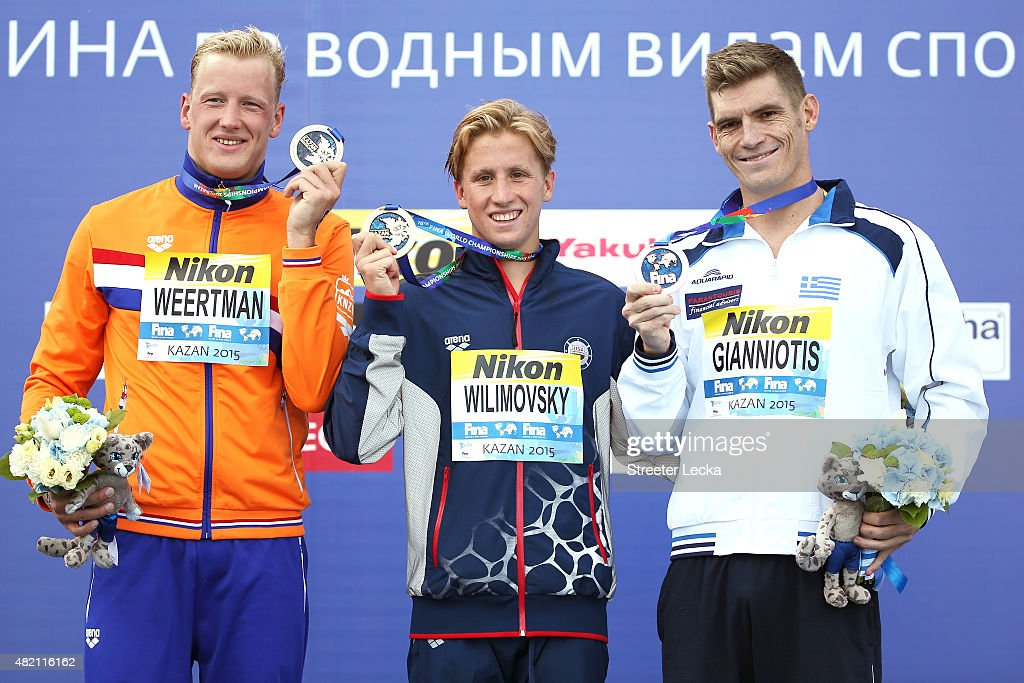 Gold medallists Jordan Wilimovsky of the United States pose with silver medallists <a gi-track='captionPersonalityLinkClicked' href=/galleries/search?phrase=Ferry+Weertman&family=editorial&specificpeople=13492831 ng-click='$event.stopPropagation()'>Ferry Weertman</a> of the Netherlands and bronze medallists <a gi-track='captionPersonalityLinkClicked' href=/galleries/search?phrase=Spyridon+Gianniotis&family=editorial&specificpeople=2333675 ng-click='$event.stopPropagation()'>Spyridon Gianniotis</a> of Greece during the medal ceremony for the Men's 10km Open Water Swimming Final on day three of the 16th FINA World Championships at the Kazanka river on July 27, 2015 in Kazan, Russia.