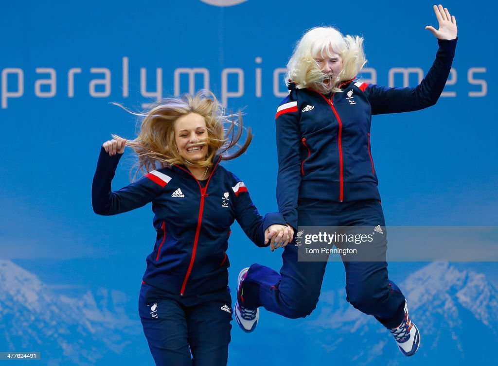 Gold medallists Kelly Gallagher of Great Britain and guide Charlotte Evans celebrate during the medal ceremony for the Women's SuperG Visually...
