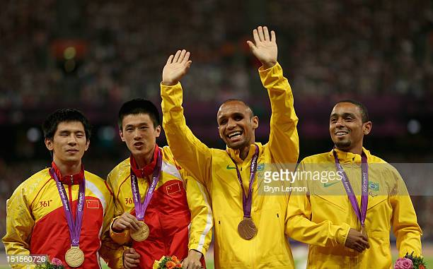 Gold medallists Lei Xue of China and guide Lin Wang and bronze medallists Felipe Gomes of Brazil and guide Leonardo Souza Lopes of Brazil pose on the...