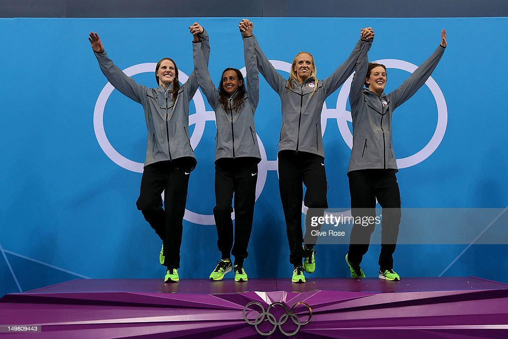 Gold medallists (L-R) <a gi-track='captionPersonalityLinkClicked' href=/galleries/search?phrase=Missy+Franklin&family=editorial&specificpeople=6623958 ng-click='$event.stopPropagation()'>Missy Franklin</a>, <a gi-track='captionPersonalityLinkClicked' href=/galleries/search?phrase=Rebecca+Soni&family=editorial&specificpeople=695876 ng-click='$event.stopPropagation()'>Rebecca Soni</a>, Dana Volmer, and <a gi-track='captionPersonalityLinkClicked' href=/galleries/search?phrase=Allison+Schmitt&family=editorial&specificpeople=4443033 ng-click='$event.stopPropagation()'>Allison Schmitt</a> of the United States celebrates on the podium during the medal ceremony for the Women's 4x100m medley Relay Final on Day 8 of the London 2012 Olympic Games at the Aquatics Centre on August 4, 2012 in London, England.