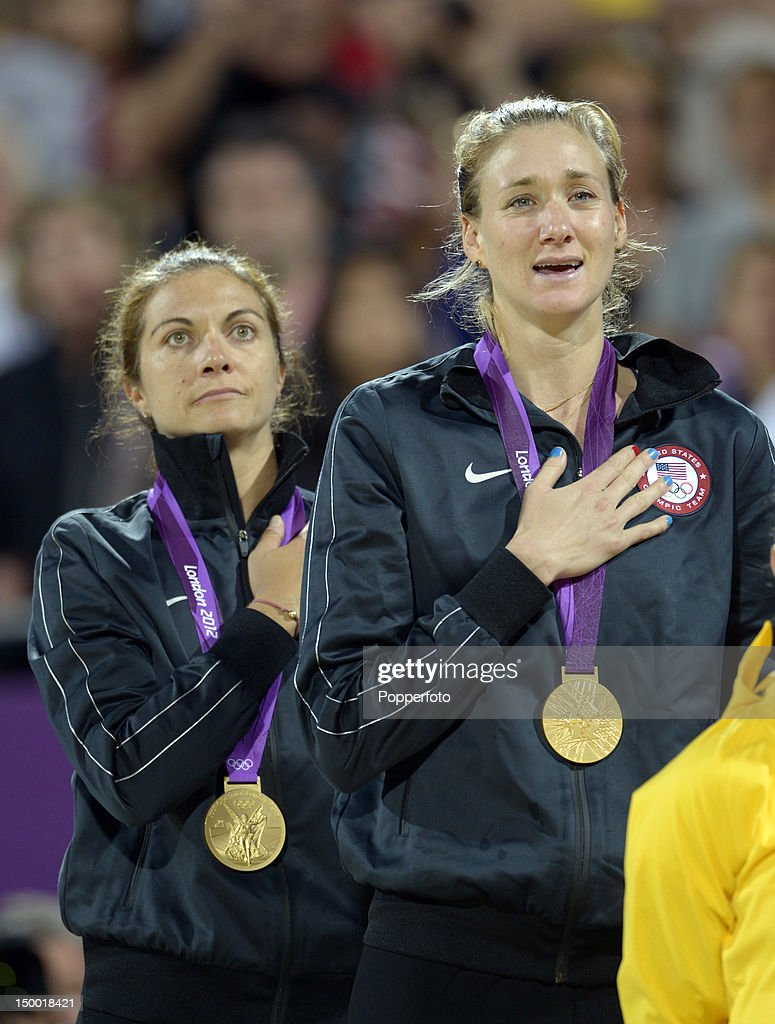 Gold medallists Misty MayTreanor and Kerri Walsh Jennings celebrate on the podium during the medal ceremony for the Women's Beach Volleyball on Day...