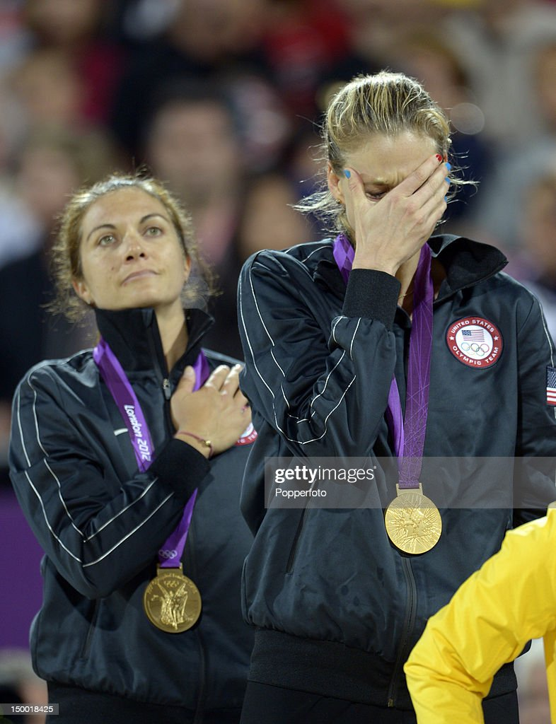 Gold medallists Misty May-Treanor (L) and Kerri Walsh Jennings celebrate on the podium during the medal ceremony for the Women's Beach Volleyball on Day 12 of the London 2012 Olympic Games at the Horse Guard's Parade on August 8, 2012 in London, England.