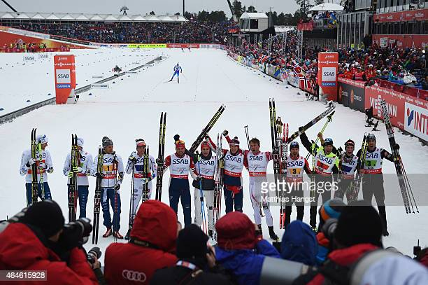 Gold medallists Niklas Dyrhaug Didrik Toenseth Anders Gloeersen and Petter Jr Northug of Norway celebrate with silver medallists Daniel Richardsson...