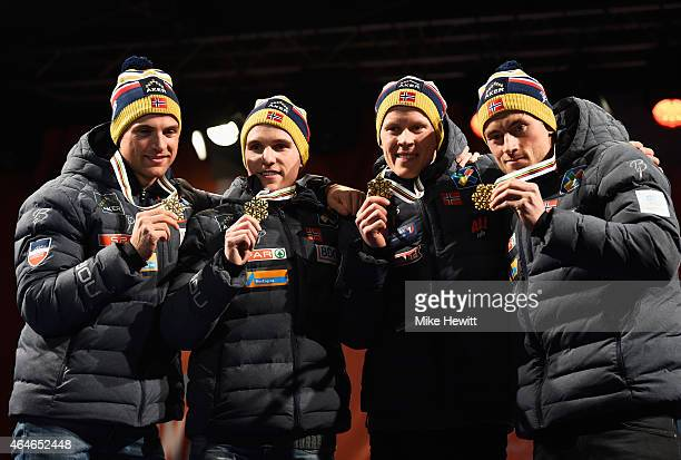 Gold medallists Niklas Dyrhaug Didrik Toenseth Anders Gloeersen and Petter Jr Northug of Norway pose during the medal ceremony for the Men's 4 x 10km...