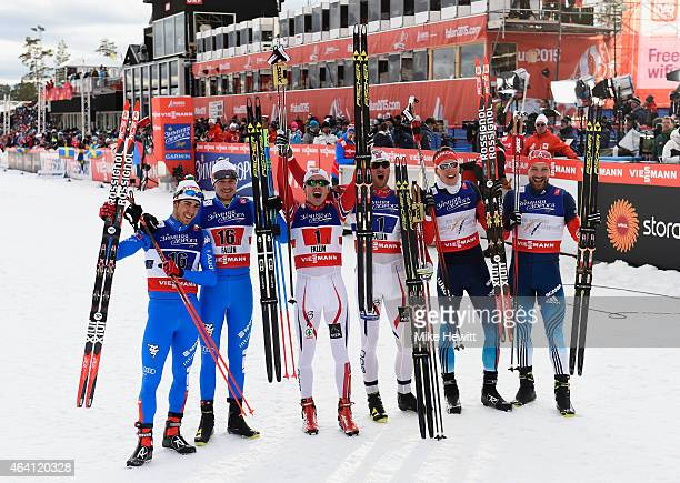 Gold medallists Petter Jr Northug and Finn Haagen Krogh of Norway pose with silver medallists Alexey Petukhov and Nikita Kriukov of Russia and bronze...