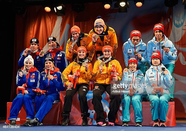 Gold medallists Richard Freitag Severin Freund Katharina Althaus and Carina Vogt of Germany pose with silver medallists Line Jahr Anders Bardal Maren...