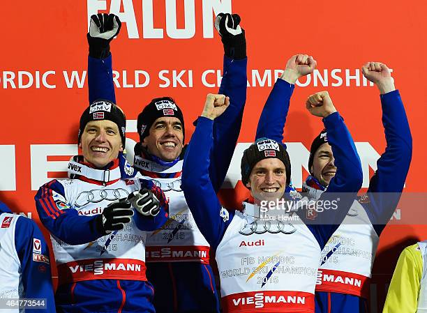 Gold medallists Rune Velta Anders Bardal Anders Fannemel and Anders Jacobsen of Norway celebrate after the Men's Team HS134 Large Hill Ski Jumping...