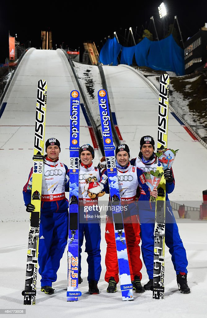 Gold medallists Rune Velta Anders Fannemel Anders Jacobsen and Anders Bardal of Norway pose after the Men's Team HS134 Large Hill Ski Jumping during...