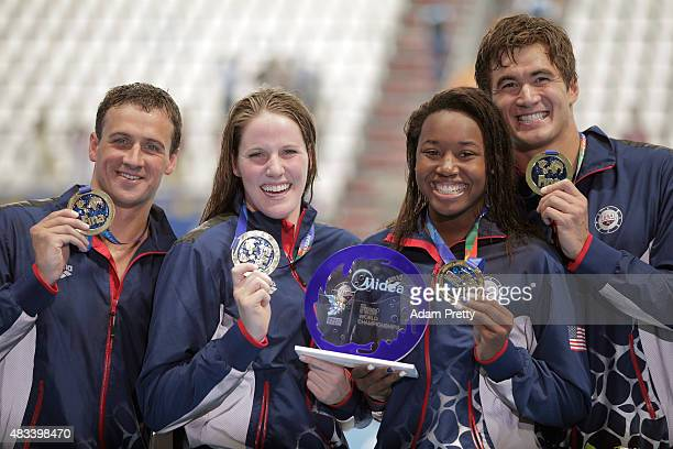 Gold medallists Ryan Lochte Missy Franklin Simone Manuel and Nathan Adrian of the United States pose during the medal ceremony after setting a new...
