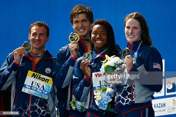 Gold medallists Ryan Lochte Nathan Adrian Simone Manuel and Missy Franklin of the United States pose during the medal ceremony after setting a new...