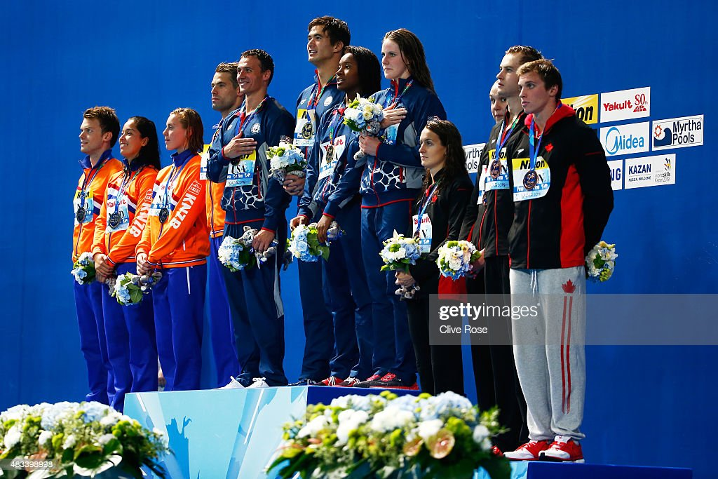 Gold medallists <a gi-track='captionPersonalityLinkClicked' href=/galleries/search?phrase=Ryan+Lochte&family=editorial&specificpeople=182557 ng-click='$event.stopPropagation()'>Ryan Lochte</a>, <a gi-track='captionPersonalityLinkClicked' href=/galleries/search?phrase=Nathan+Adrian+-+Nageur&family=editorial&specificpeople=712694 ng-click='$event.stopPropagation()'>Nathan Adrian</a>, Simone Manuel and <a gi-track='captionPersonalityLinkClicked' href=/galleries/search?phrase=Missy+Franklin&family=editorial&specificpeople=6623958 ng-click='$event.stopPropagation()'>Missy Franklin</a> of the United States pose with silver medallists <a gi-track='captionPersonalityLinkClicked' href=/galleries/search?phrase=Ranomi+Kromowidjojo&family=editorial&specificpeople=4209840 ng-click='$event.stopPropagation()'>Ranomi Kromowidjojo</a>, <a gi-track='captionPersonalityLinkClicked' href=/galleries/search?phrase=Femke+Heemskerk&family=editorial&specificpeople=4209839 ng-click='$event.stopPropagation()'>Femke Heemskerk</a>, Joost Reijns and Sebastiaan Verschuren of the Netherlands and bronze medallists Yuri Kisil, <a gi-track='captionPersonalityLinkClicked' href=/galleries/search?phrase=Chantal+Van+Landeghem&family=editorial&specificpeople=8006425 ng-click='$event.stopPropagation()'>Chantal Van Landeghem</a>, Sandrine Mainville and Santo Condorelli of Canada during the medal ceremony in the Mixed 4x100m Freestyle Relay Final on day fifteen of the 16th FINA World Championships at the Kazan Arena on August 8, 2015 in Kazan, Russia.