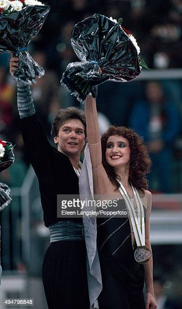 Gold Medallists Sergei Ponomarenko and Marina Klimova of Russia celebrating during the awards ceremony following their performace in the pairs...