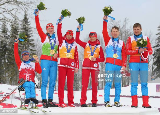Gold medallists Svetlana Konovalova Alena Kaufman Elena Remizova guide Natalia Yakimova Nikolay Polukhin and guide Andrey Tokarev of the Russian...