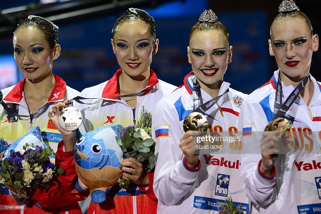 Gold medallists Svetlana Romashina and Russia's <a gi-track='captionPersonalityLinkClicked' href=/galleries/search?phrase=Svetlana+Kolesnichenko&family=editorial&specificpeople=7986692 ng-click='$event.stopPropagation()'>Svetlana Kolesnichenko</a> (R) and silver medallists Jiang Wenwen and China's Jiang Tingting pose on the podium during the award ceremony of the duet free final during the synchronised swimming competition in the FINA World Championships at the Palau Sant Jordi in Barcelona, on July 25, 2013.