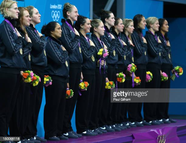 Gold medallists the United States listen to their national anthem on the podium during the medal ceremony for the Women's Water Polo on Day 13 of the...