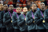 Gold medallists the United States pose on the podium during the medal ceremony for the Men's Basketball gold medal game between the United States and...