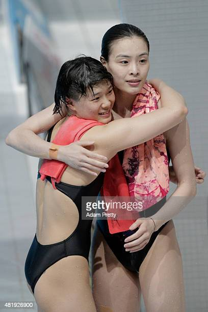 Gold medallists Tingmao Shi and Minxia Wu of China celebrate during the Women's 3m Springboard Synchronised Diving Final on day one of the 16th FINA...