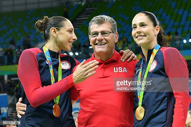 Gold medallists USA's guard Diana Taurasi USA's head coach Geno Auriemma and USA's guard Sue Bird pose after the final of the Women's basketball...
