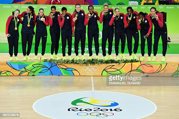 Gold medallists USA's guard Lindsay Whalen USA's forward Seimone Augustus USA's guard Sue Bird USA's forward Maya Moore USA's small forward Angel...