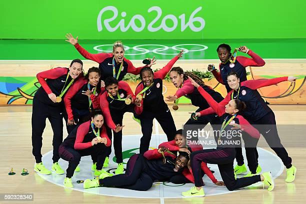 TOPSHOT Gold medallists USA's guard Lindsay Whalen USA's guard Sue Bird USA's forward Seimone Augustus USA's forward Maya Moore USA's power forward...