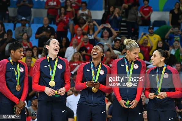 Gold medallists USA's small forward Angel Mccoughtry USA's power forward Breanna Stewart USA's forward Tamika Catchings USA's small forward Elena...