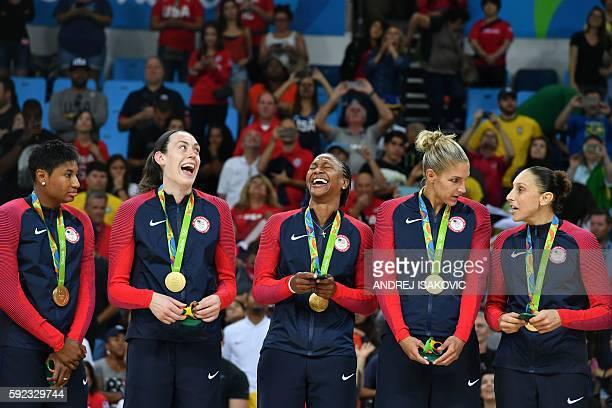 Gold medallists USA's small forward Angel Mccoughtry USA's power forward Breanna Stewart USA's forward Tamika Catchings USA's small forward Elena...
