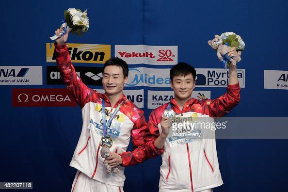 Gold medallists Yuan Cao and Kai Qin of China pose during the medal ceremony for the Men's 3m Springboard Synchronised Diving Final on day four of...