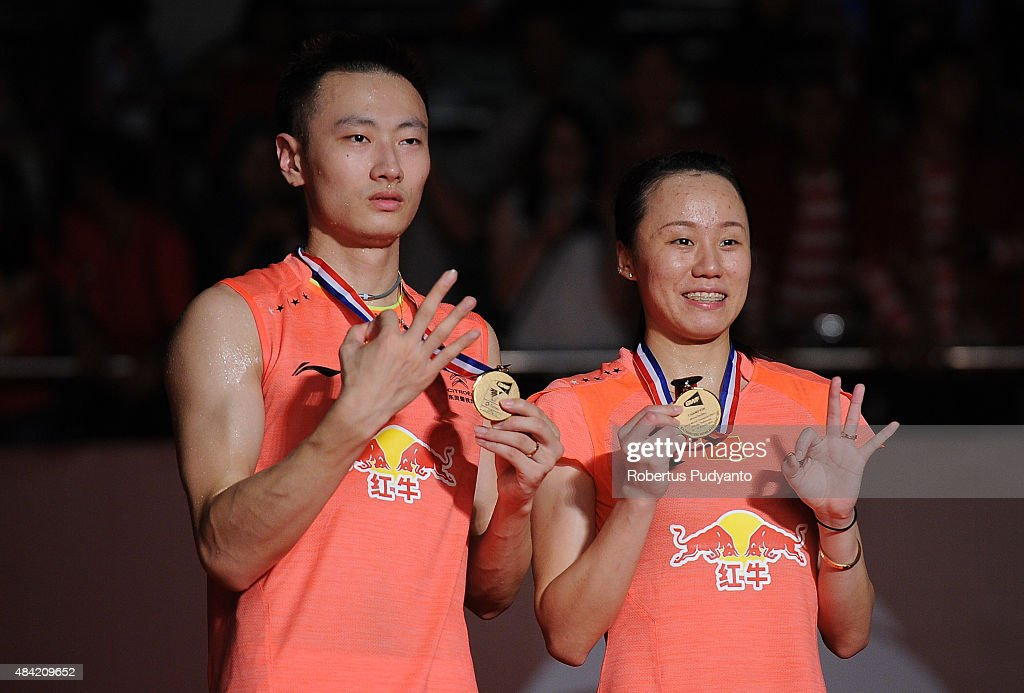Gold medals winner <a gi-track='captionPersonalityLinkClicked' href=/galleries/search?phrase=Zhang+Nan+-+Badminton+Player&family=editorial&specificpeople=9612243 ng-click='$event.stopPropagation()'>Zhang Nan</a> and <a gi-track='captionPersonalityLinkClicked' href=/galleries/search?phrase=Zhao+Yunlei&family=editorial&specificpeople=5534160 ng-click='$event.stopPropagation()'>Zhao Yunlei</a> of China celebrate on the podium during the mixed doubles awarding ceremony of the 2015 Total BWF World Championship at Istora Senayan on August 16, 2015 in Jakarta, Indonesia.