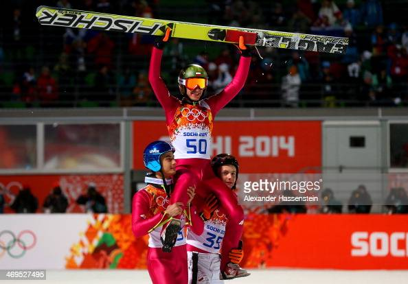 Gold medlaist Kamil Stoch of Poland is lifted on the shoulders of Maciej Kot of Poland and Jan Ziobro of Poland after the Men's Large Hill Individual...
