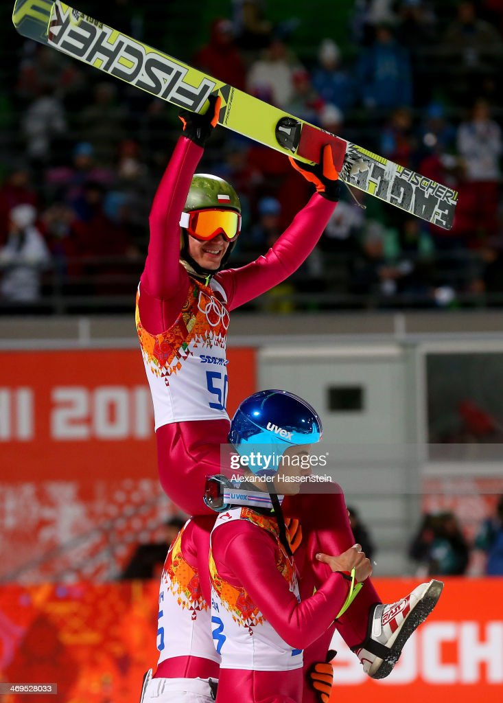 Gold medlaist Kamil Stoch of Poland is lifted on the shoulders of Maciej Kot of Poland and Jan Ziobro of Poland after the Men's Large Hill Individual Final Round on day 8 of the Sochi 2014 Winter Olympics at the RusSki Gorki Ski Jumping Center on February 15, 2014 in Sochi, Russia.