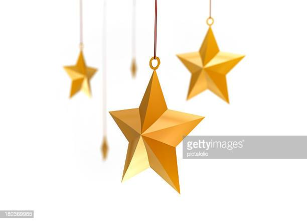 Gold metal stars hanging from above, on white