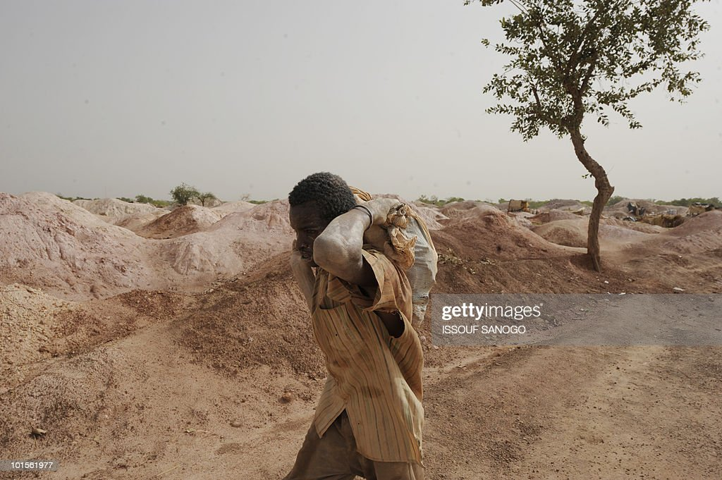 A gold miner carries a bag of stones hoping to find some gold inside it, in Namisgma on May 9, 2010. Namisgma is the most important gold site in Burkina Faso and is situated in the northern part of the country.