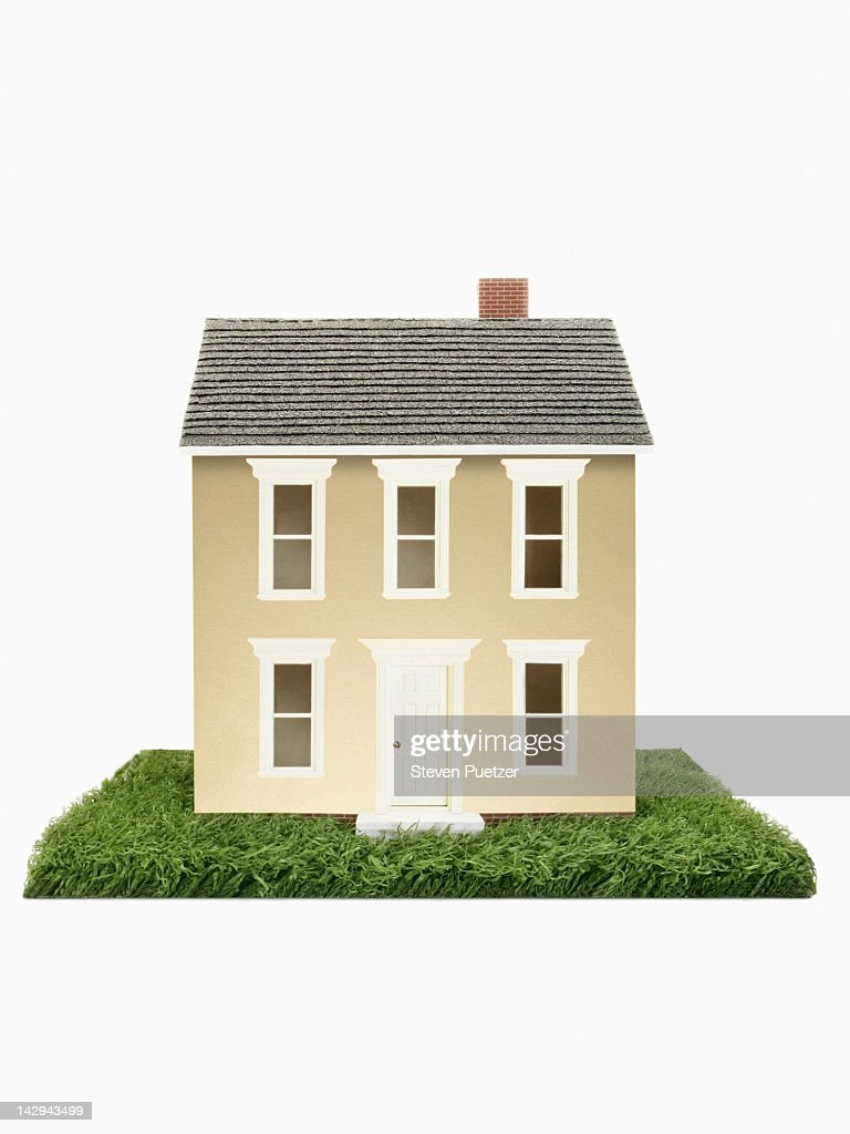 Gold model house on green grass : Stock Photo