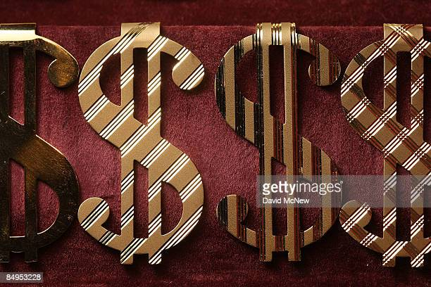 Gold money clips in the shape of US dollar symbols are displayed for sale February 20 2009 in Los Angeles California Gold futures finished the day...