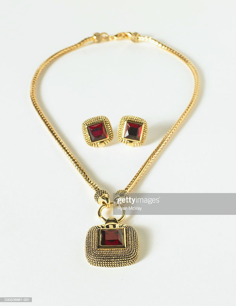Gold necklace and earrings, elevated view