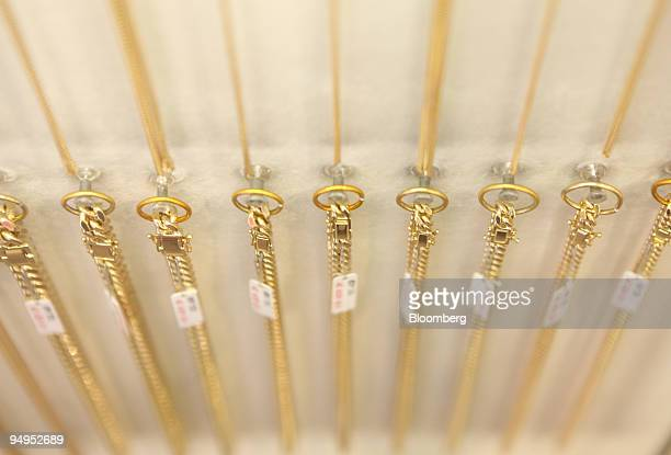 Gold necklaces are displayed at a Ryutsu jewelry shop in Tokyo Japan on Tuesday Sept 8 2009 Gold rose to the highest price since March 2008 passing...
