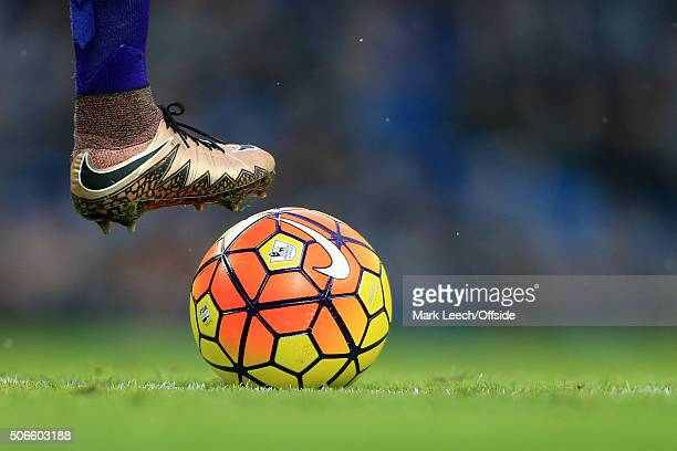 A gold Nike boot rests on an orange sunburst Nike winter matchball during the Barclays Premier League match between Manchester City and Crystal...