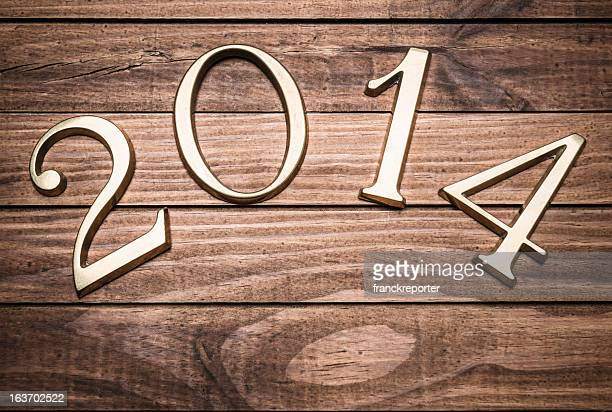 2014 gold numbers on wood background