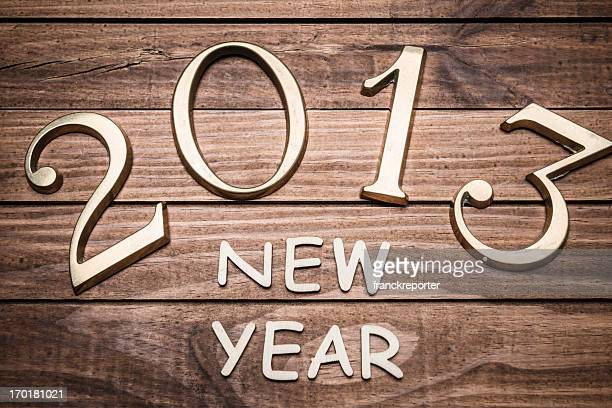 2013 gold numbers on wood background
