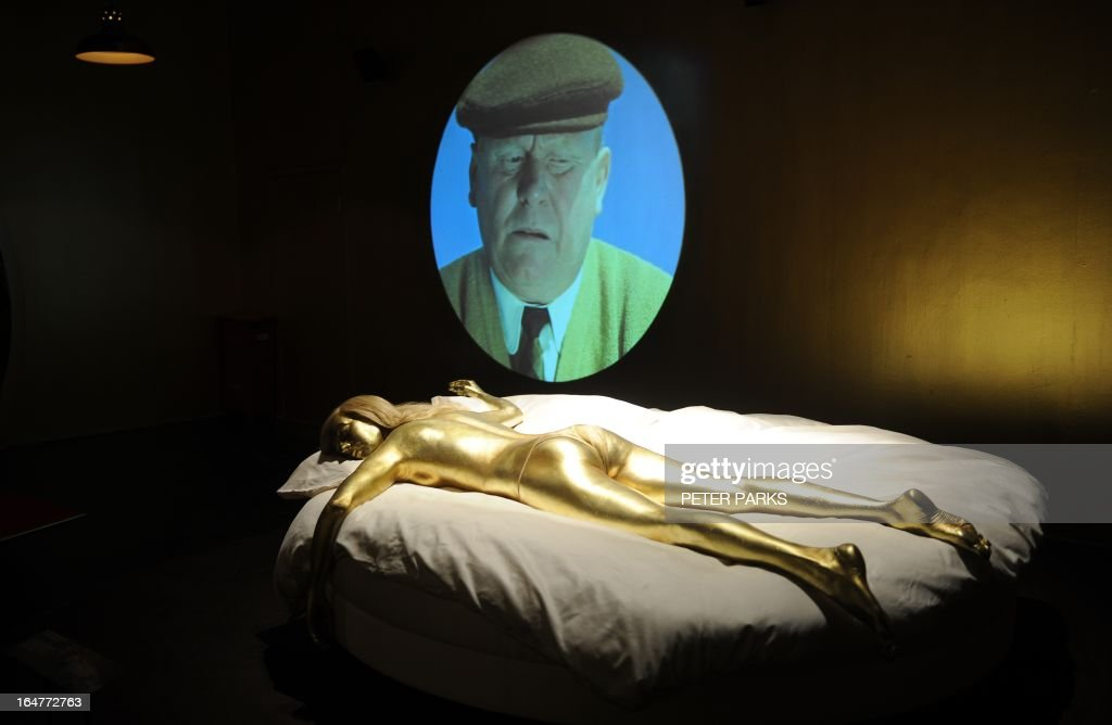 A gold painted model of a Bond girl from the James Bond movie Goldfinger is seen at an exhibition on the fictional British spy in Shanghai on March 28, 2013. The exhibition opened in Shanghai just weeks after the Communist government's censors cut parts of the latest film in the franchise, 'Skyfall' with a scene showing prostitution in Macau, a special administrative region of China, was removed, as was a line in which Bond's nemesis mentions being tortured by Chinese security agents. AFP PHOTO/Peter PARKS