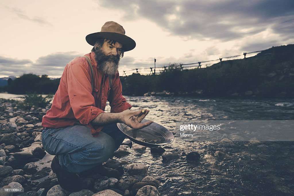 'Gold Panning,Successful Prospector with Nugget'