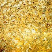 gold plates on buddha