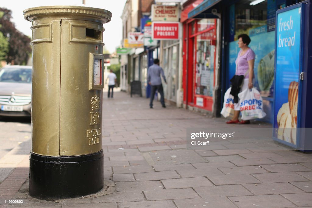A gold post box in Isleworth on August 6, 2012 in London, England. The post box was painted gold to celebrate British athlete Mo Farah's victory in the Men's 10,000m race at the London 2012 Olympic Games on Saturday and is located close to where Mo trained and went to school.