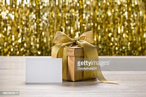 Gold present and place card : Stock Photo